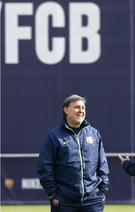 Barcelona's coach Gerardo Tata Martino smiles during a training session at Ciutat Esportiva Joan Gamper in Sant Joan Despi in Barcelona