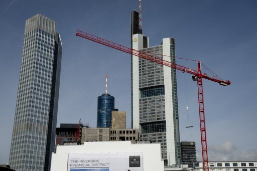 <p>A new development under construction in Frankfurt, in September. The German government has fractionally upgraded its growth forecast for the current year, but slashed its prognosis for next year.</p>