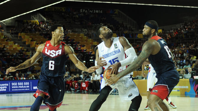 Dominican Republic's forward Jack Martinez (C) vies with US centre DeMarcus Cousins (R) and guard Derrick Rose during the 2014 FIBA World basketball championships in Bilbao on September 3, 2014