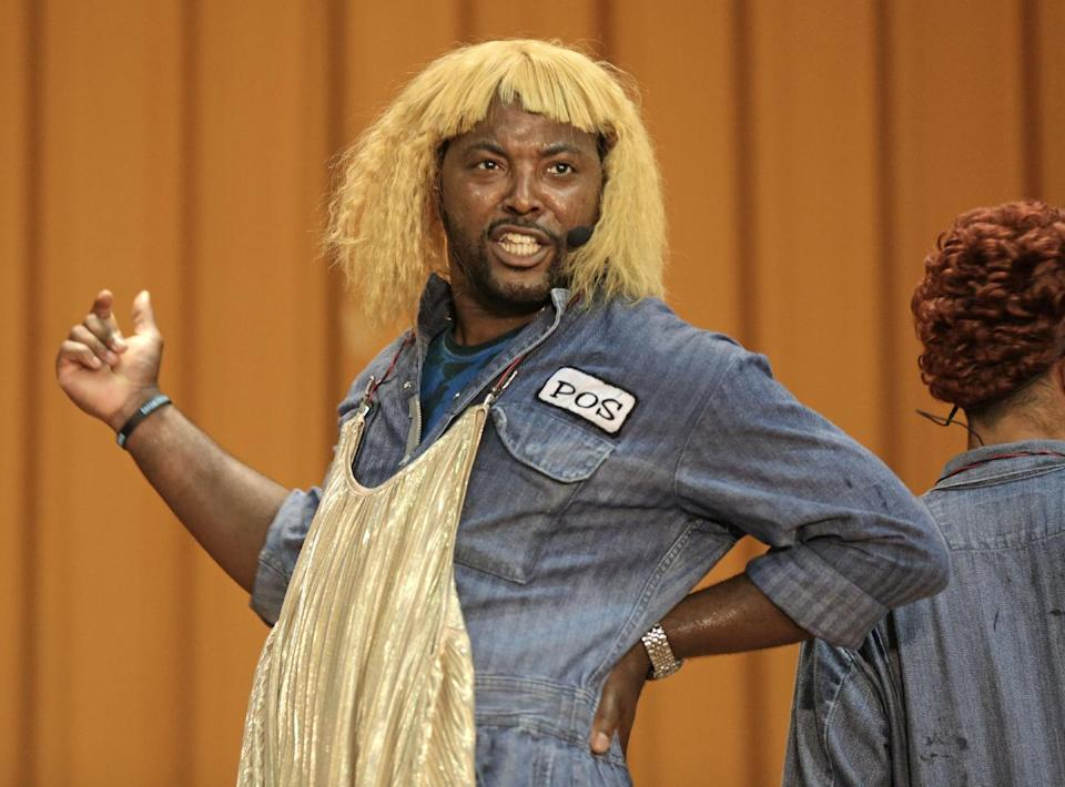 "In this Aug. 27, 2013, photo, rapper Postell Pringle wears a wig as he performs in a hip hop adaptation of William Shakespeare's Othello, titled ""Othello: The Remix"" at the Cook County Jail in Chicago. (AP Photo/M. Spencer Green)"