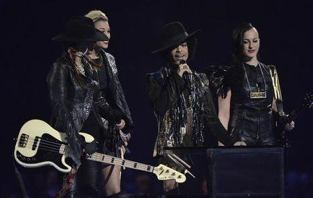 Prince and his band 3rdEyeGirl present the award for British Female Solo Artist at the BRIT Awards, celebrating British pop music, at the O2 Arena in London