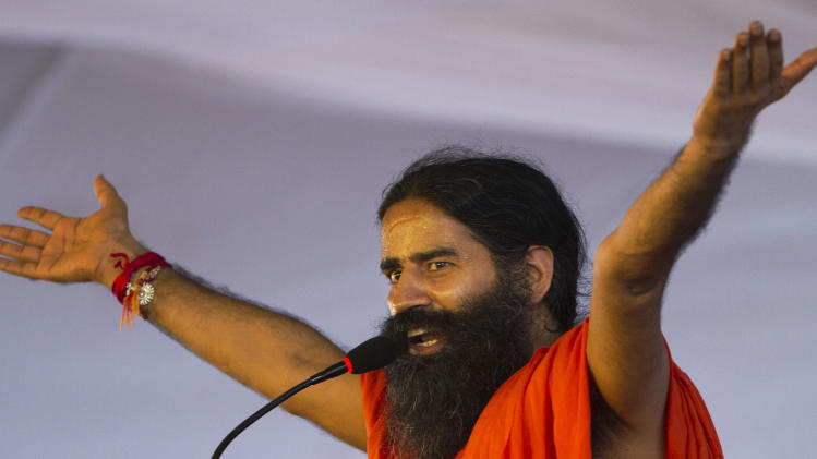 Indian yoga guru Baba Ramdev gestures as he speaks during a protest in  New Delhi, India, Sunday, Aug. 12, 2012. Ramdev fasted for a fourth day Sunday and threatened to expand his protest nationwide if the government doesn't act decisively to bring back billions of dollars of ill-gotten money that some Indians have allegedly stashed abroad. (AP Photo/Rajesh Kumar Singh)