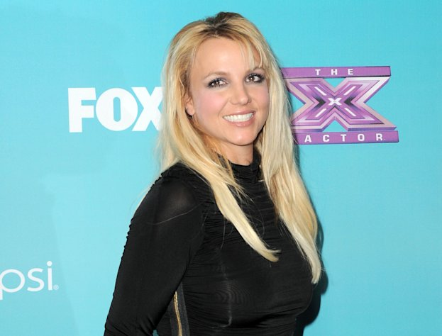 "FILE - This Nov. 5, 2012 file photo shows singer and celebrity judge Britney Spears at the ""X-Factor"" Finalists Party in Los Angeles. A person familiar with plans for Fox's ""The X Factor"" says Britney Spears is out of the show. Spears was a mentor on the singing contest for one season, reportedly drawing a $15 million paycheck but failing to pull reviews to match. The person who confirmed reports of her departure wasn't authorized to comment publicly, speaking Thursday on condition of anonymity. (Photo by Jordan Strauss/Invision/AP, file)"