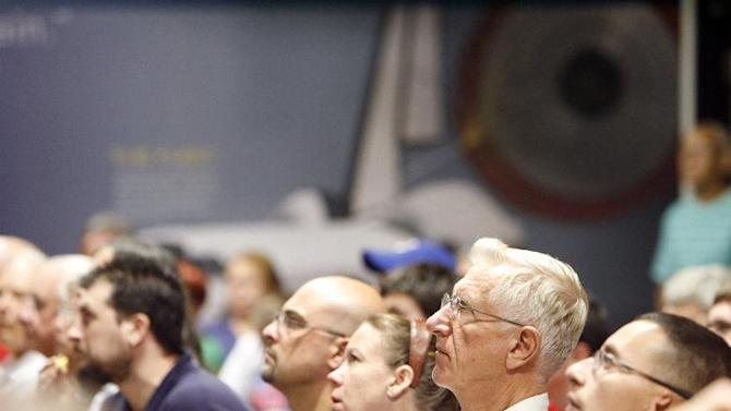 A crowd of people attend the Mars Curiosity Landing Party early Monday morning, Aug. 6, 2012, at the Kansas Cosmosphere and Space Center in Hutchinson, Kan. (AP Photo/The Hutchinson News, Lindsey Bauman)