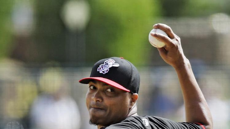 Cincinnati Reds pitcher Alfredo Simon delivers against the Los Angeles Dodgers in the first inning of a spring exhibition baseball game Thursday, March 13, 2014, in Glendale, Ariz