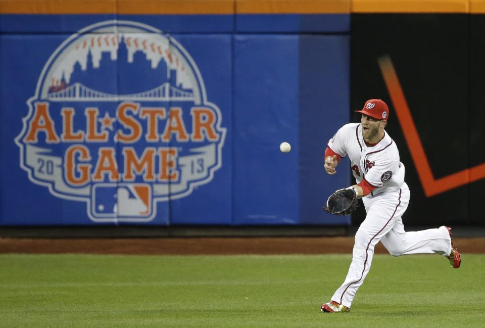 National League's Bryce Harper, of the Washington Nationals, catches a fly ball to center field during the first inning of the MLB All-Star baseball game, on Tuesday, July 16, 2013, in New York. (AP Photo/Matt Slocum)