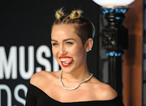 FILE - This Aug. 25, 2013 file photo shows singer Miley …
