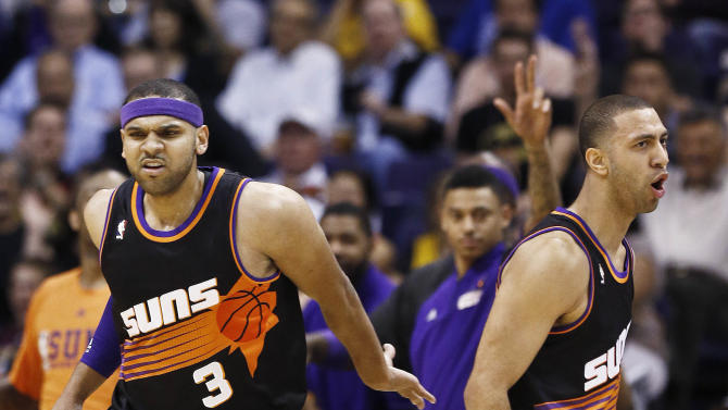 Phoenix Suns' Kendall Marshall, right celebrates his made jump shot against the Los Angeles Lakers with teammate Jared Dudley (3) in the first half of an NBA basketball game on Monday, March 18, 2013, in Phoenix. (AP Photo/Ross D. Franklin)