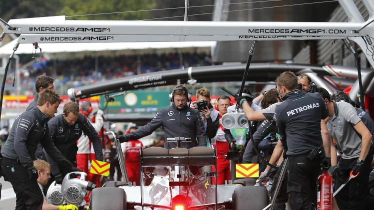 Mercedes Formula One driver Hamilton arrives in the garage during a practice session at the Belgian F1 Grand Prix in Spa-Francorchamps