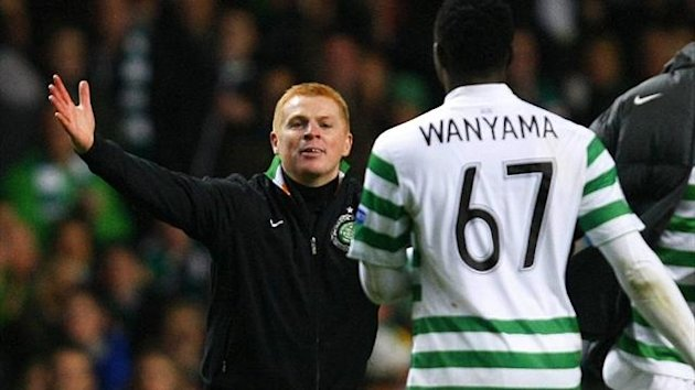 Celtic manager Neil Lennon celebrates their victory over Barcelona with Victor Wanyama (Reuters)