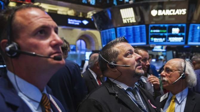 Traders work on the floor of the New York Stock Exchange shortly after the market's opening in New York