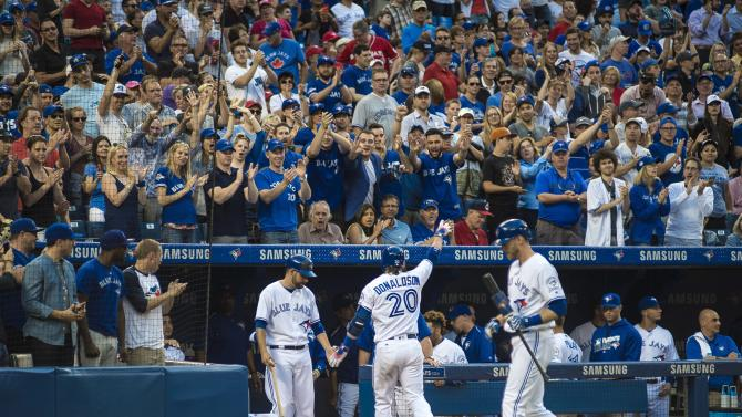 Toronto Blue Jays' Josh Donaldson receives cheers from fans as he returns to the dugout after a fourth-inning home run in a baseball game against the Cleveland Indians on Thursday, June 30, 2016, in Toronto. (Eduardo Lima/The Canadian Press via AP)