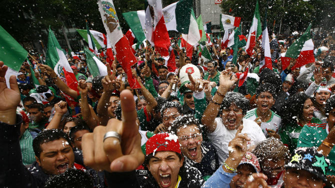 Fans of Mexico's soccer team celebrate after their team beat Brazil in the men's soccer final at the London 2012 Summer Olympics, below the Angel of Independence monument in Mexico City, Saturday, Aug. 11, 2012. Mexico won the match 2-1 and the gold.(AP Photo/Marco Ugarte)