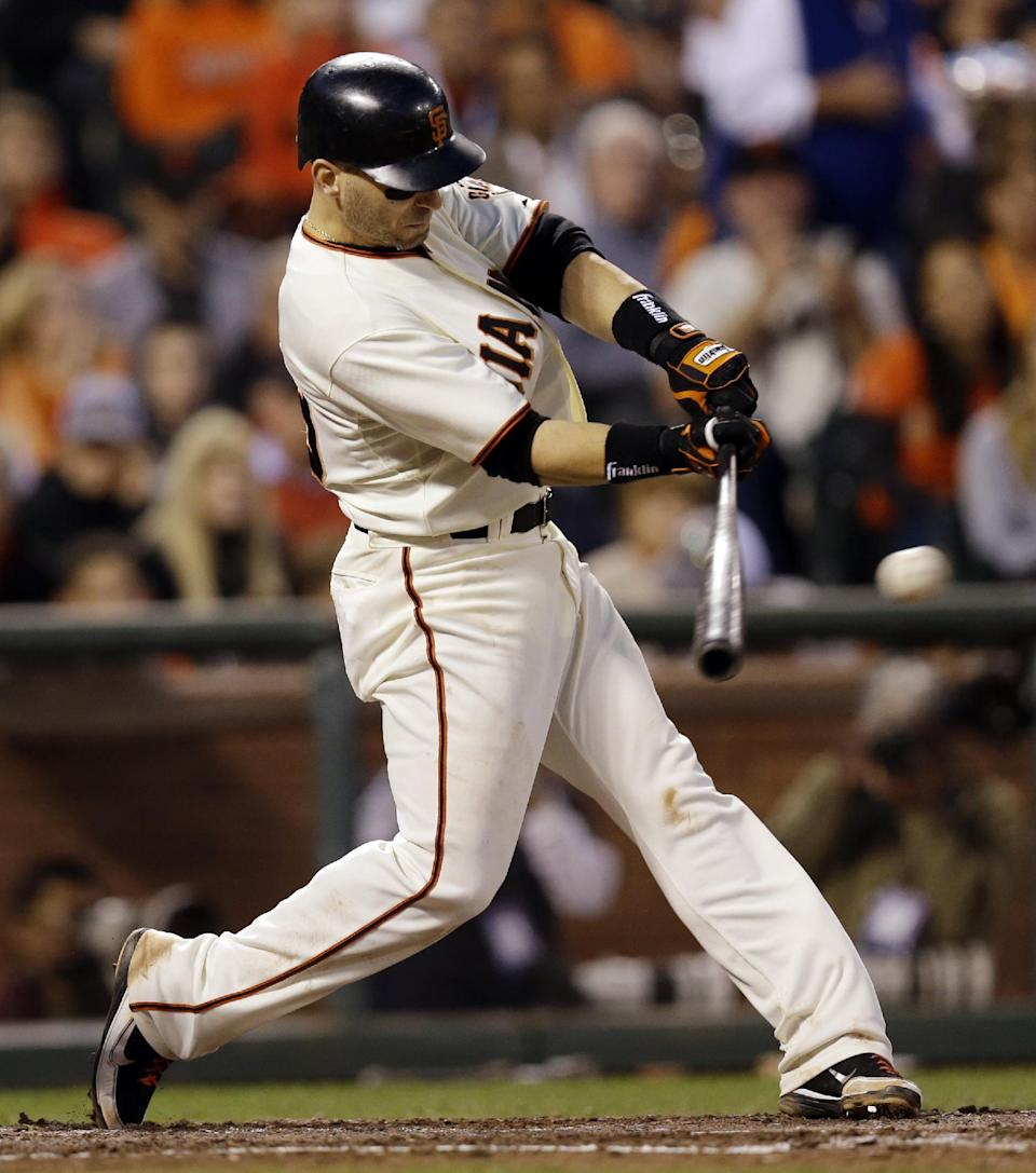 San Francisco Giants' Marco Scutaro hits a three-run hit during the fourth inning of Game 2 of baseball's National League championship series against the St. Louis Cardinals Monday, Oct. 15, 2012, in San Francisco. (AP Photo/David J. Phillip)