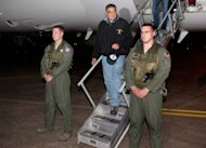 US Secretary of Defense Leon Panetta (C) disembarks from his aircraft after arriving at US Yokota air base in Japan. Panetta said the US military did not plan to bolster its forces in the Middle East and North Africa, despite the threat of more violent protests targeting diplomatic outposts across the region