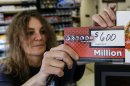 Sheila Sutton updates the Powerball prize money sign at the Super C convenience store in Lincoln, Neb., Friday, May 17, 2013. Powerball officials say the jackpot has climbed to an estimated $600 million, making it the largest prize in the game&#039;s history and the world&#039;s second largest lottery prize. Sutton sold a million dollar powerball ticket on Tuesday. (AP Photo/Nati Harnik)