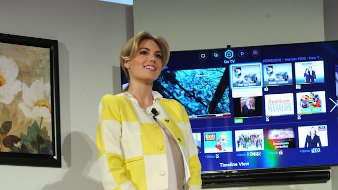 Model Kate Upton helps Samsung showcase its 2013 line of Smart TVs, Wednesday, March 20, 2013, in New York.  Samsung's new line allows the viewer to discover more of the TV they love with a simpler, more personalized and smarter way of watching TV.  (Photo by Diane Bondareff/Invision for Samsung/AP Images)