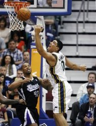 Utah Jazz center Enes Kanter (0) reaches for a rebound again Sacramento Kings forward Chuck Hayes (42) during the first half of their NBA basketball game in Salt Lake City, Friday, March 30, 2012. (AP Photo/Steve C. Wilson)