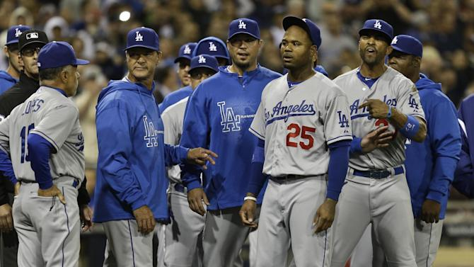 Los Angeles Dodgers' Carl Crawford, (#25), Matt Kemp, right, Josh Beckett, third from left, and manager Don Mattingly, fourth from left, stand in front of the San Diego Padres dugout in a confrontation following a brawl during the eighth inning of baseball game in San Diego, Thursday, April 11, 2013. The braw started when San Diego Padres' Carlos Quentin was hit by a pitch from Dodgers pitcher Zack Greinke.  (AP Photo/Lenny Ignelzi)