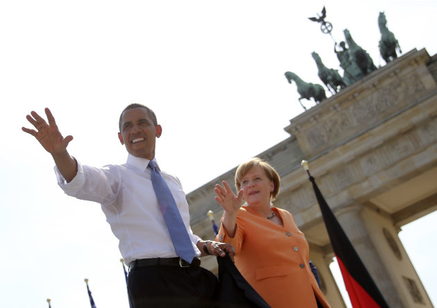 German Chancellor Merkel watches as U.S. President Obama waves after giving a speech in front of the Brandenburg Gate at Pariser Platz in Berlin