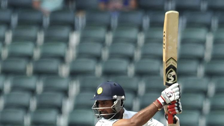 India's Shikhar Dhawan plays a shot during the third day of their cricket test match against South Africa in Johannesburg