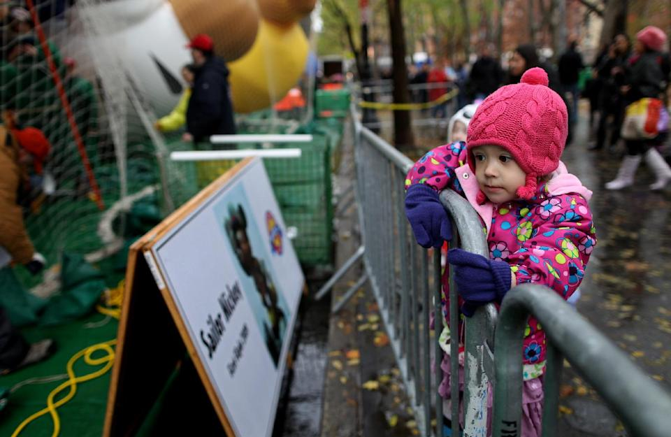 Madeline Adams, 3, of New York watches as participants in Macy's department store's 85th annual parade inflate giant helium balloons, Wednesday, Nov. 23, 2011 in preparation for Thursday's parade in New York. (AP Photo/Craig Ruttle)