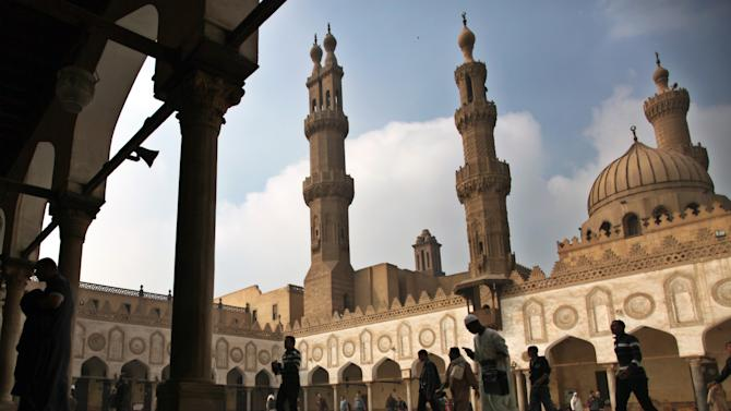 """FILE - In this Friday, Dec. 28, 2012 file photo, Muslims arrive to attend the Friday prayer at Al-Azhar mosque in Cairo, Egypt. Dar el-Ifta, the top Islamic authority in Egypt, revered by many Muslims worldwide, launched Sunday an internet-based campaign aimed particularly at the West against an extremist group in Syria and Iraq, saying it is not an """"Islamic State."""" The Grand Mufti of Egypt, Shawki Allam, and clerics from the oldest Islamic learning institute, Al-Azhar, have condemned the Islamic State saying it was violating all Islamic principles and laws, describing it as a danger to the religion. (AP Photo/Khalil Hamra, File)"""