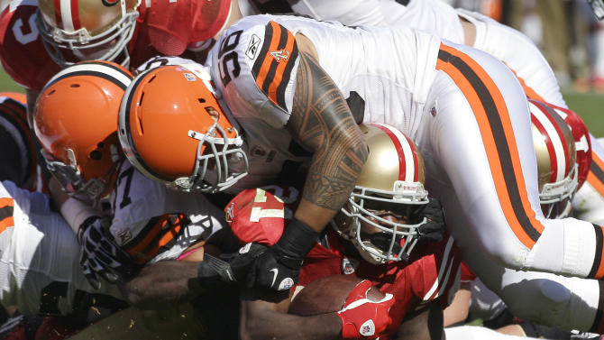 San Francisco 49ers running back Frank Gore (21) is stopped on fourth down at the 1-yard line by Cleveland Browns linebacker Kaluka Maiava (56) and other defenders in the second quarter of an NFL football game in San Francisco, Sunday, Oct. 30, 2011. (AP Photo/Marcio Jose Sanchez)