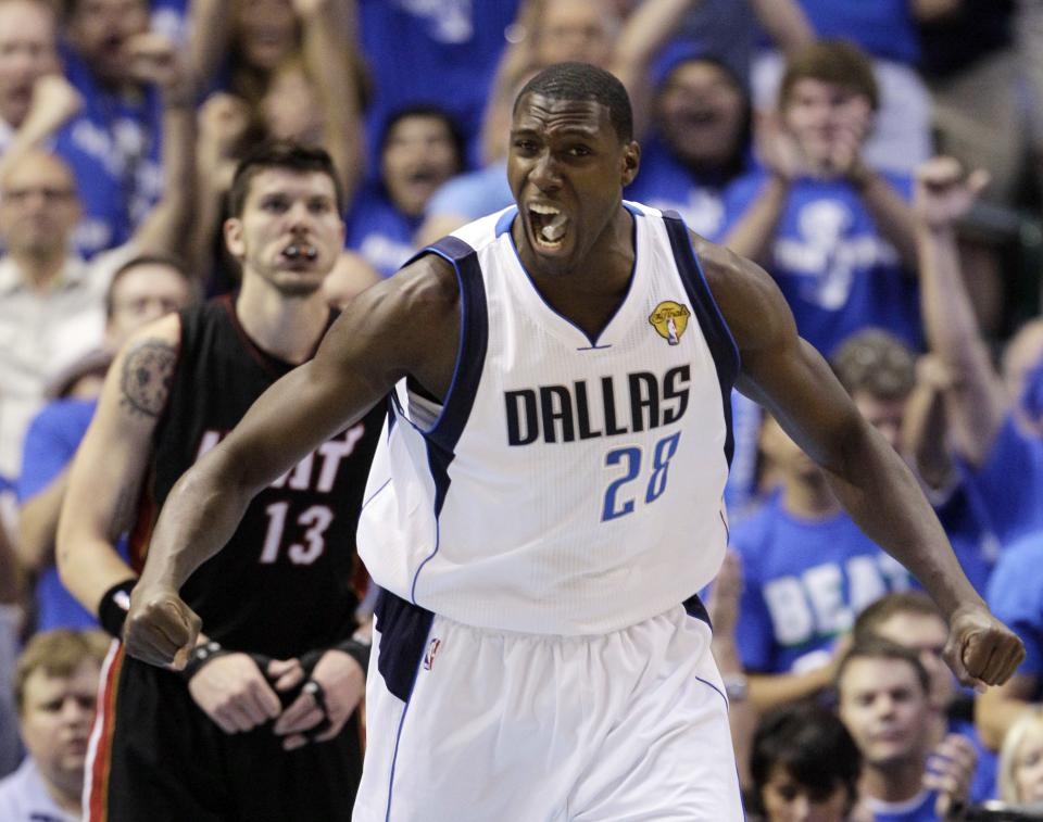 Dallas Mavericks' Ian Mahinmi (28) reacts in front of Miami Heat's Mike Miller (13) after scoring during the first half of Game 5 of the NBA Finals basketball game Thursday, June 9, 2011, in Dallas. (AP Photo/Mark Humphrey)