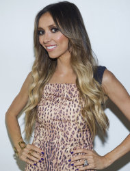 "FILE - In a Monday, Sept. 12, 2011 file photo, ""E! News"" co-host Giuliana Rancic attends the Rachel Zoe Spring 2012 fashion show during Mercedes-Benz Fashion Week in New York. Rancic says she has early stages of breast cancer. The 37-year-old made the announcement Monday, Oct. 16, 2011 on NBC's ""Today"" show. (AP Photo/Charles Sykes, File)"
