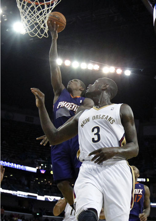 Phoenix Suns point guard Eric Bledsoe goes to the basket in front of New Orleans Pelicans shooting guard Anthony Morrow (3) in the second half of an NBA basketball game in New Orleans, Tuesday, Nov. 5