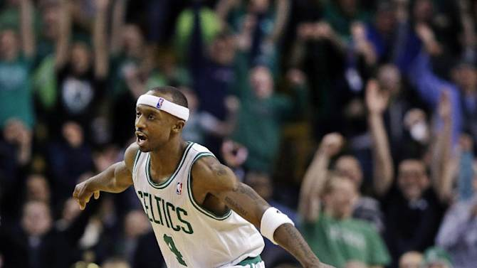 Boston Celtics guard Jason Terry (4) reacts to the crowd after hitting a 3-pointer against the Denver Nuggets late in triple overtime of their NBA basketball game in Boston, Sunday, Feb. 10, 2013. The Celtics won 118-114. (AP Photo/Elise Amendola)