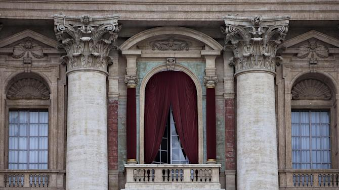 A view of the balcony on the facade of St. Peter's Basilica where the newly elected Pope will make his first appearance to salute the cheering crowd, at the Vatican Monday, March 11, 2013. Cardinals have gathered for their final day of talks before the conclave to elect the next pope amid debate over whether the Catholic Church needs a manager pope to clean up the Vatican's messy bureaucracy or a pastoral pope who can inspire the faithful and make Catholicism relevant again. (AP Photo/Oded Balilty)