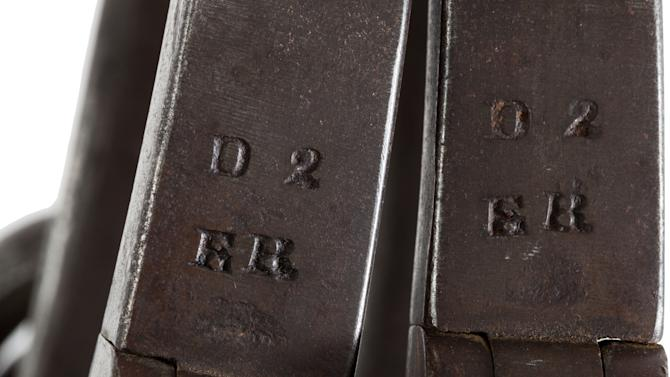 """This June 17, 2013 provided by Heritage Auctions, shows a close-up of the leg irons that were placed on John Brown shortly after his arrest at Harper's Ferry, W.Va. The irons are stamped """"ER"""" in two places. The initials """"ER"""" stand for Elijah Rickard, a well-known locksmith who operated out of Shepherdstown, Virginia. believed to be those used on John Brown during his incarceration at the Charlestown, W.Va., jail following his arrest during the raid at Harper's Ferry W.Va. John Brown's capture of the Federal Arsenal at Harper's Ferry on Oct. 17, 1859 as part of a failed attempt to incite a slave uprising is seen by most historians as the spark that ignited the Civil War. They have been passed down in the family of John Boling, of Idaho, for six generations, after being obtained by a decedent shortly after Brown's execution. They are expected to bring more than $10,000 when they come up for auction on June 22, 2013. (AP Photo/Heritage Auctions)"""