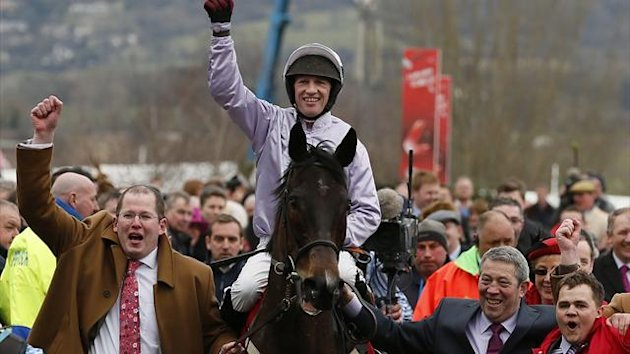 Paul Carberry on Solwhit celebrates after winning the World Hurdle Race at the Cheltenham Festival (Reuters)