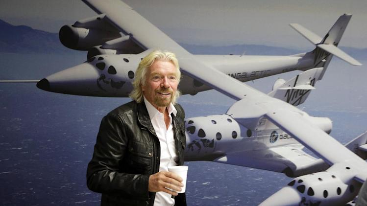 "FILE - This Sept. 25, 2013 file photo shows British entrepreneur Richard Branson at the Virgin Galactic hangar at Mojave Air and Space Port in Mojave, Calif. NBC says it will air a competition show with an out-of-this-world prize: a ride into space. The network said Thursday, Oct. 3, that TV producer Mark Burnett is teaming with Richard Branson's Virgin Galactic on ""Space Race,"" a game where the winner will get a ride on Virgin's aircraft atop the Earth's atmosphere. (AP Photo/Reed Saxon, File)"