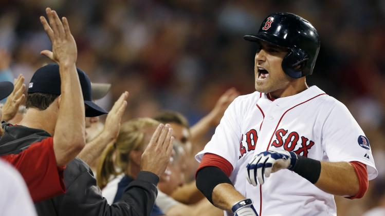 Boston Red Sox's Will Middlebrooks celebrates his solo home run in the fourth inning of a baseball game against the New York Yankees in Boston, Sunday, Aug. 18, 2013. (AP Photo/Michael Dwyer)
