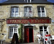 &#39;The Famous Knight&#39; pub is pictured in Couptrain, northwestern France, owned by British national Steve Skews. With its cosy atmosphere, a menu offering home-cooked fish and chips and hand-operated pumps spouting foaming pints of bitter beer, the Famous Knight seems like the epitome of a typical English pub