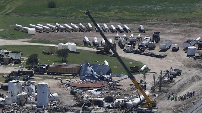 Damage from the West, Texas, fertilizer plant explosion is seen from helicopters as President Barack Obama travels to a memorial in Waco, Texas, Thursday, April 25, 2013. (AP Photo/Charles Dharapak)