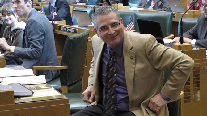 Rep. Bill Kennemer sits on the House floor at the Oregon state Capitol in Salem on Wednesday, Feb. 20, 2013. Kennemer sponsored a bill, approved unanimously, designating Aug. 9 as Boring and Dull Day to commemorate the pairing of Boring Ore., and Dull, Scotland, two towns that bonded over their ho-hum names. (AP Photo/Jonathan J. Cooper)