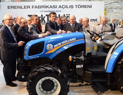 CNH Industrial CEO Richard Tobin (far left) and Chairman of the Board of Koc Holding, Mustafa V. Koc (third from right), sign a New Holland tractor that will be manufactured at the second CNH Industrial and Koc Holding joint venture manufacturing plant in Turkey, inaugurated yesterday.