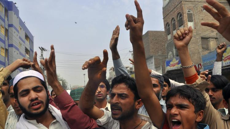 Protesters chant slogan as they react to a rumour that a member of the Hindu community had desecrated the Koran, in Larkana