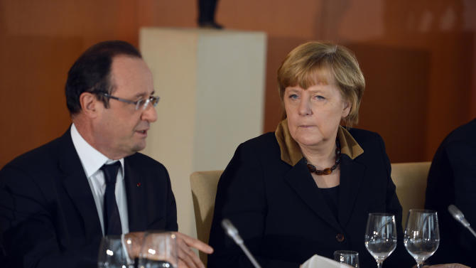 French President Francois Hollandeand German Chancellor Angela Merkel, from left, attend the French-German cabinet meeting in Berlin, Germany, Tuesday, Jan. 22, 2013,as part of the celebration to mark 50 years since the Elysee Treaty launched after WWII a French-German cooperation. (AP Photo/Odd Andersen, Pool)