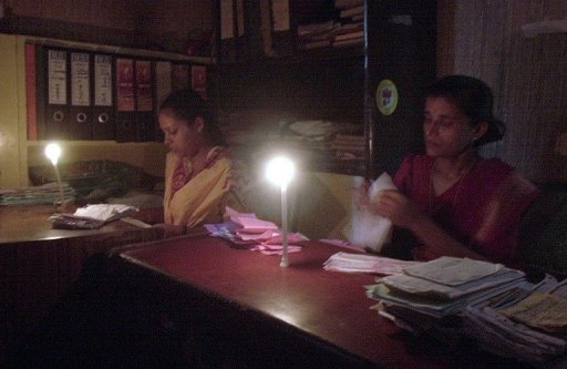 <p>This file photo shows office staff working by candlelight during a power cut in New Delhi, in 2002. A massive power cut blacked out a vast swathe of northern India early Monday, affecting hundreds of millions of people in nine states including the capital New Delhi, according to officials.</p>