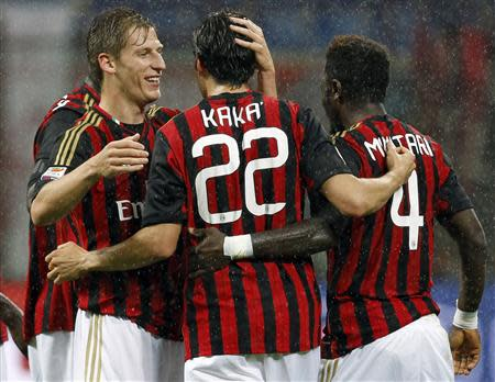 AC Milan's Kaka celebrates with his team mates Birsa and Muntari after scoring against Lazio during their Italian Serie A soccer match in Milan