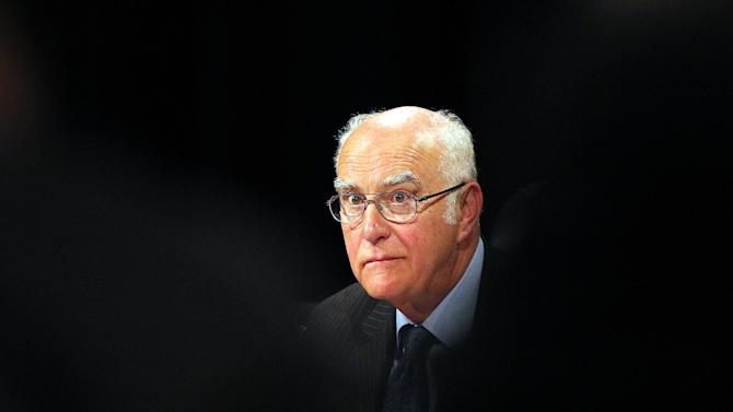Retired judge Ian Farlamat looks on during a judicial commission of inquiry at the Civic Centre in Rustenburg, South Africa, Monday, Oct. 1, 2012.  Farlam, began conducting an official inquiry Monday into the killings of dozens of people near a South African platinum mine, even as labor unrest continued with workers at other mines as well as truck drivers continuing protests over pay. (AP Photo/Themba Hadebe)