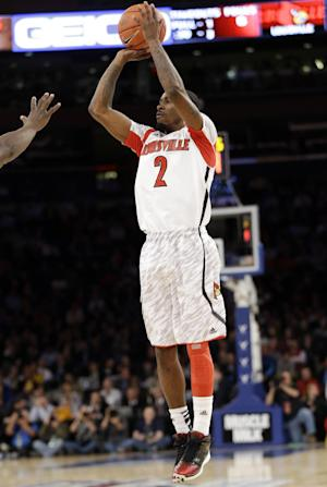 Louisville's Russ Smith (2) shoots during the first half of an NCAA college basketball game against Villanova at the Big East Conference tournament, Thursday, March 14, 2013, in New York. (AP Photo/Frank Franklin II)
