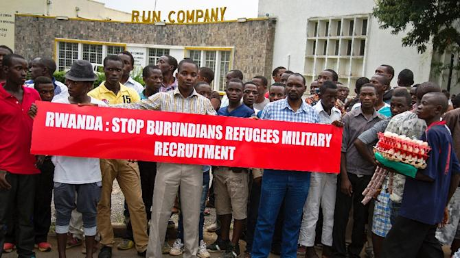 Burundian protesters hold banners at Bujumbura airport on January 21, 2016