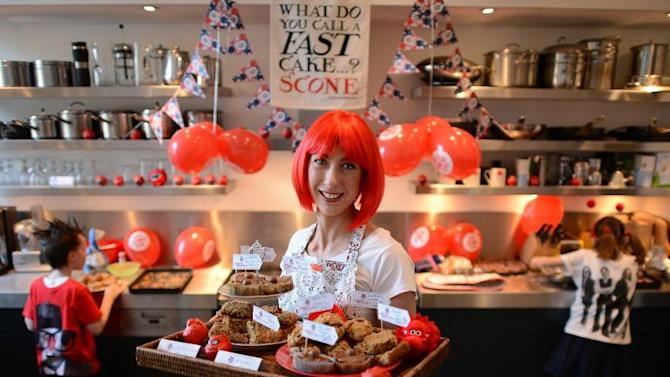 Samantha Cameron, the wife of Prime Minister David Cameron, poses for photos after baking cakes in aid of Comic Relief, at 10 Downing Street in London, on March 5, 2013