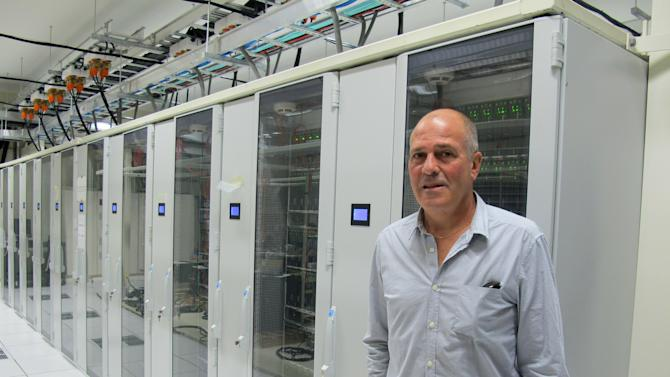 "In this Nov. 14, 2012 photo, Weta Digital General Manager Tom Greally stands in front of a large bank of servers  with the computing power of 30,000 laptops used for animation work in the companies Wellington studios in New Zealand. Weta Digital is the centerpiece of a filmmaking empire that Peter Jackson and close collaborators have built in his New Zealand hometown, realizing his dream of bringing a slice of Hollywood to Wellington. It's a one-stop shop for making major movies - not only his own, but other blockbusters like ""Avatar"" and ""The Avengers"" and hoped-for blockbusters like next year's ""Man of Steel.""  (AP Photo/Nick Perry)"